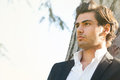 Model handsome Italian elegant man. Intense outdoor light. Royalty Free Stock Photo