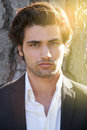 Model handsome Italian elegant man. Intense outdoor light. Royalty Free Stock Photo