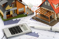 Model house and calculator Royalty Free Stock Photo