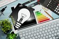 Energy Efficiency Rating - House with Light Bulb Royalty Free Stock Photo