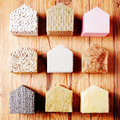 Model houses with various insulation on the table close up aligned small top of wooden Royalty Free Stock Image