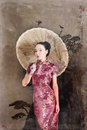 Model Japanese red dress stands with an umbrella. Geisha Royalty Free Stock Photo