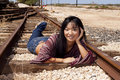 Model laying on Train Tracks Royalty Free Stock Photos