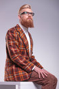 Model with long beard looking up to his side relaxed male and glasses Royalty Free Stock Photo