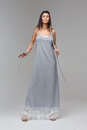 Model in long grey lace nighty standing in studio Royalty Free Stock Photo