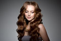 Model with long hair. Waves Curls Hairstyle. Hair Salon. Updo. F Royalty Free Stock Photo