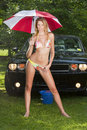 Model with a Modern Muscle Car Royalty Free Stock Image