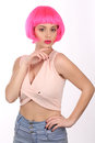 Model with pink hair posing. Close up. White background Royalty Free Stock Photo