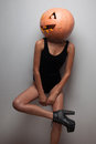 Model posing with pumpkin on head fashionable slim indoors Stock Photos
