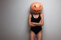 Model posing with pumpkin on head slim studio Royalty Free Stock Image