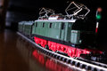 Model railroad with steam locomotive by night Stock Photography