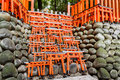 Model of red japanese gates little wooden torii gate at fushimi inari shrine photo taken on april Royalty Free Stock Image