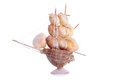 Model sailboat of seashells on an isolated background Stock Images