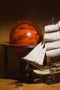 Model sailing ship and old globe Royalty Free Stock Photo