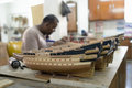 Model ship factory mauritius may an unidentified person make a in on may in mauritius wooden replica of old famous sailfish is the Stock Image