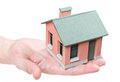 Model of the small house in human hands. Royalty Free Stock Photo