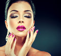 Model with trendy makeup smokey eyes fuchsia lips and nails Royalty Free Stock Photos
