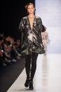 A model walks on the Viva Vox catwalk. FALL 2015 Royalty Free Stock Photo