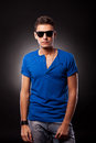 Model wearing blue T-shirt and sunglasses Royalty Free Stock Photography
