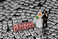 Model wedding couple standing on letter jewellery beads Royalty Free Stock Photo