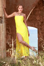 Model in yellow dress posing outdoor happy female an setting Stock Image