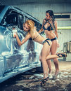 Models at the car wash in garage Royalty Free Stock Image