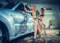 Models at the car wash in garage Stock Photo