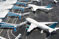 Models of modern aircraft standing at miniature airport white Stock Photo