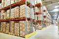 Moderm warehouse interior of modern rows of shelves with boxes Royalty Free Stock Images