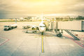 Modern airplane at the terminal gate in international airport Royalty Free Stock Photo