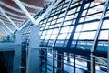 Modern airport interior glass wall aisle window Royalty Free Stock Photo