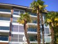 Modern apartment block with palms Royalty Free Stock Photography