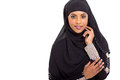Modern arabic woman on white background Stock Photo