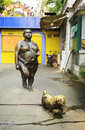 Modern art city sculpture statue of fat woman and dog walking on sidewalk street view and urban scenery in china Stock Photography