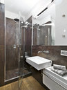 Modern bahtroom panoramic view of bathroom with glass shower cubicle and washbasin Royalty Free Stock Photography