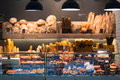 Modern bakery with different kinds of bread cakes and buns Royalty Free Stock Photography