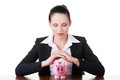 Modern bank model business woman sitting with piggy bank isolated on white Royalty Free Stock Photos