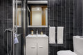 Modern bathroom with black tiles Royalty Free Stock Photo