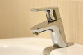 Modern bathroom chrome faucet Royalty Free Stock Photo