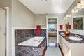 Modern bathroom interior in master bedroom with granite tile trim hardwood floor and white vanitry cabinet Stock Images