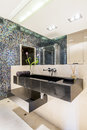 Modern bathroom with mosaic tiles Royalty Free Stock Photo