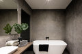Modern bathroom wall made in dark color tiles Royalty Free Stock Photo
