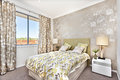 Modern bedroom with a master bed and light brown color Royalty Free Stock Photo