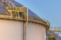 Modern big oil storage tanks with Detail of steps and stairs Royalty Free Stock Photo