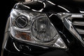 Modern black car headlights. Royalty Free Stock Photo