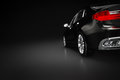 Modern black metallic sedan car in spotlight. Generic desing, brandless. Royalty Free Stock Photo