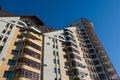 Modern brick multistory house on deep blue sky bac Royalty Free Stock Photo