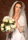 Modern Bride With Brick Background Stock Photo