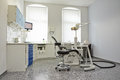 Modern bright treatment room in dental practice with chair Royalty Free Stock Photography