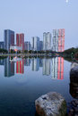 Modern building at dusk and foreground is a calm lake liuzhou downtown china Royalty Free Stock Photography